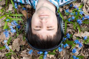 Man in headphones. Flowers